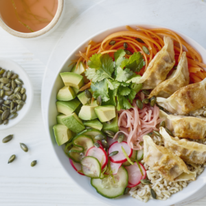 Brown rice buddha bowl with quick pickled veg and crispy sesame tuna gyoza 300x300