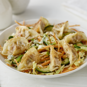 Crunchy asian salad with peanut dressing and king prawn gyoza 300x300
