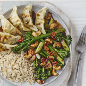 Stir fry garlic and soy tenderstem broccoli with steamed vegetable fusion gyoza 300x300